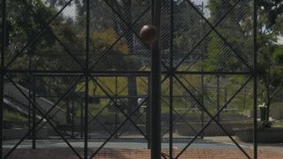Basketballs being shot in a street rink